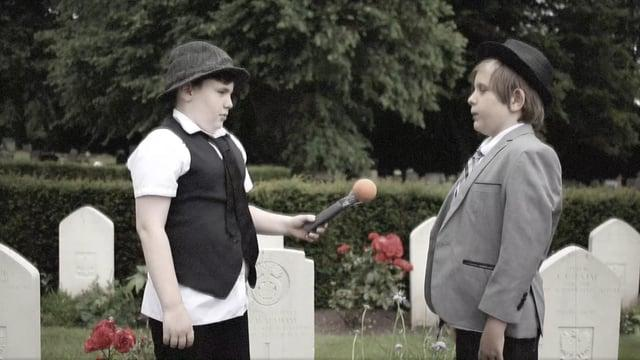 Victoria C.P School go back in time to present the news from Wrexham Cemetery.